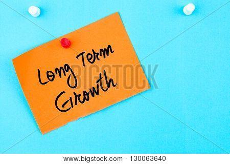 Long Term Growth Written On Orange Paper Note