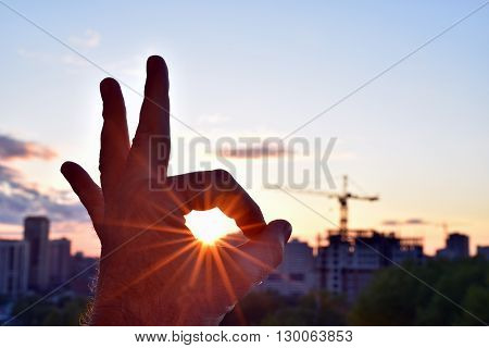 Everything will be fine -   the sun inside the ok gesture