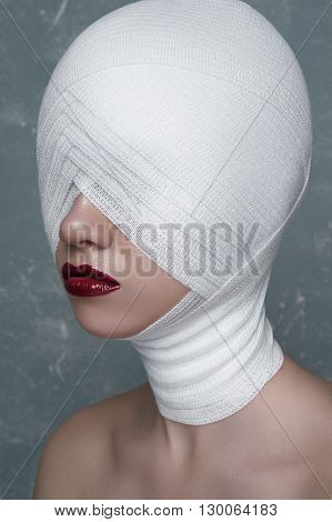 Female Patient with medical white Bandage on her Face