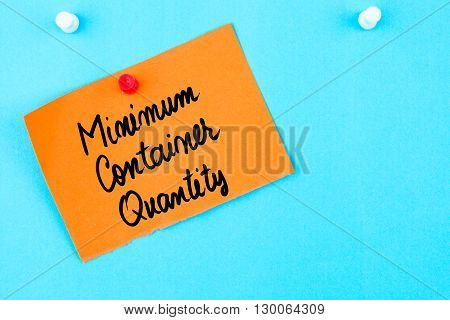 Minimum Container Quantity Written On Orange Paper Note