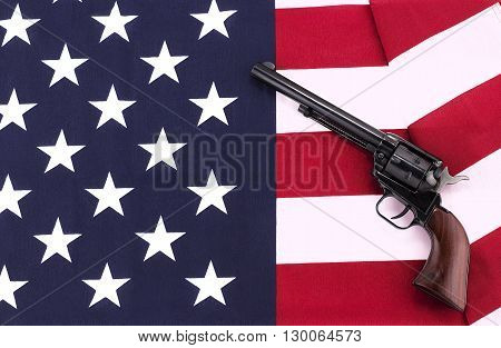 A Revolver laying on an American flag