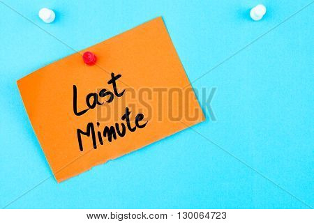 Last Minute Written On Orange Paper Note