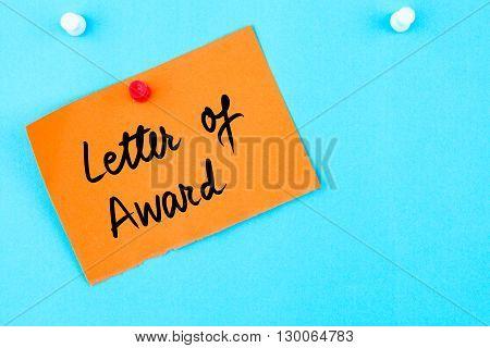 Letter Of Award Written On Orange Paper Note
