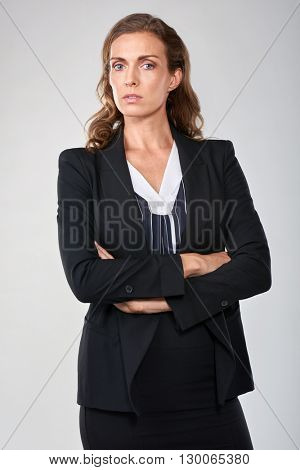 Portrait of middle age woman in middle upper management, serious professional executive