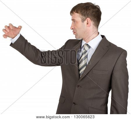 Angry man holding copyspace isolated on white background