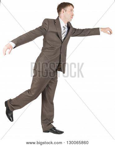 Businessman balancing on one leg isolated on white background