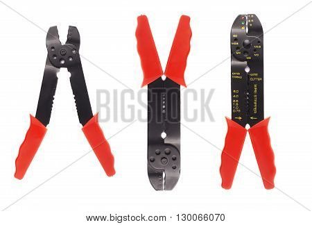 Set of wire stripper with red handles over white isolated background, different foreshortenings