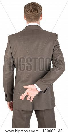 Businessman with his fingers crossed behind his back isolated on white background