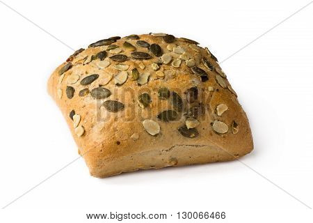 Single pumping seed wholemeal bun isolated on white closeup.