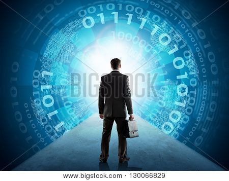 Businessman with suitcase standing in front of matrix background