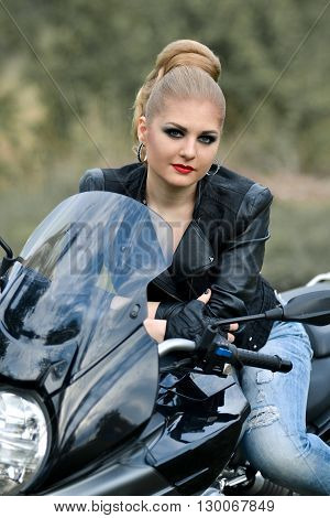 Interesting,glamour,nice,rebel girl sitting on motorbike,fashionable girl with motorbike with leather jacket,blue jeans,smokey eyes,red lips,rebel girl and motorbike,professional rider,mad speed,road.