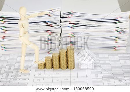 Wooden Dummy Step Up With Pile Gold Coins And House
