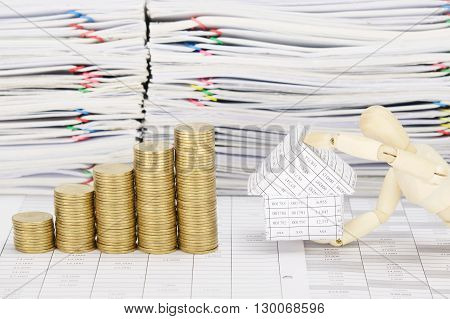 Wooden Dummy Holding House With Step Pile Of Gold Coins