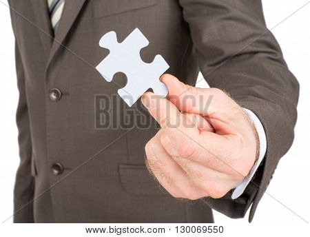 Business man showing jigsaw puzzle piece. Concept for business strength and success.