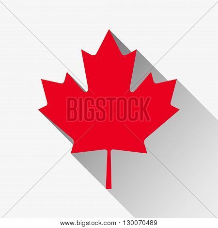 Red maple leaf with a long shadow on a white background