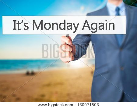 It's Monday Again - Businessman Hand Holding Sign