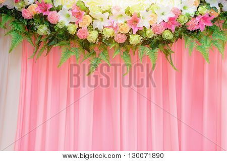 Wedding archway with flowers arranged in hotel for a wedding ceremony