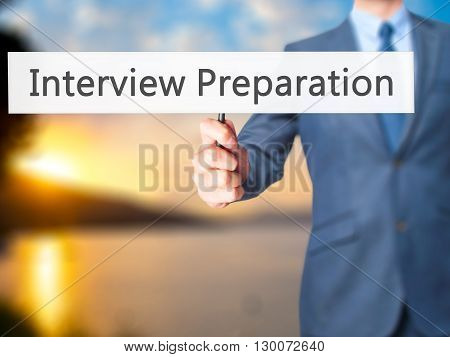 Interview Preparation - Businessman Hand Holding Sign