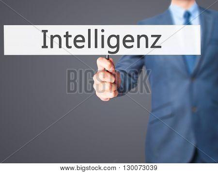 Intelligenz (intelligence In German)  - Businessman Hand Holding Sign