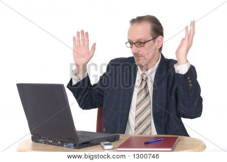 Surprised Looking Businessman Working On Laptop