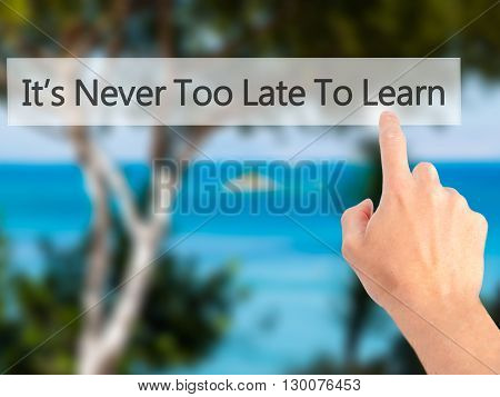 It's Never Too Late To Learn - Hand Pressing A Button On Blurred Background Concept On Visual Screen