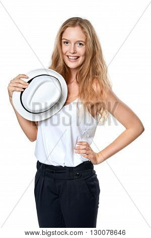 Happy woman with straw hat smiling at camera