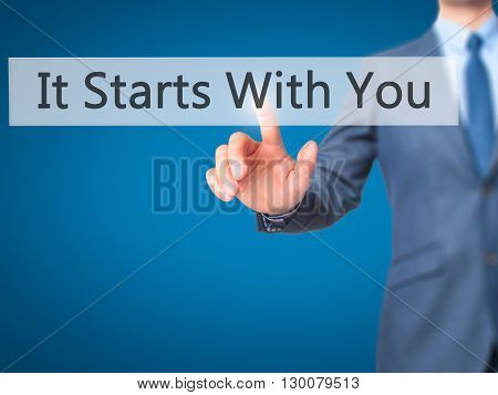 It Starts With You - Businessman Hand Pressing Button On Touch Screen Interface.