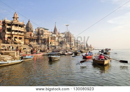 VARANASI, INDIA - DECEMBER 27: everyday ceremony of ablution in ganga river on December 27, 2013 in Varanasi.
