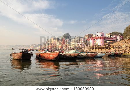 VARANASI INDIA - DECEMBER 27: raw of ten boats on December 27 2013 in Varanasio