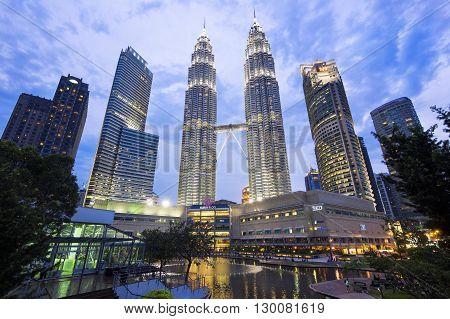Kuala Lumpur, Malaysia - April 21, 2014: View of famous Petronas Towers lit up at twilight in Kuala Lumpur, Malaysia.