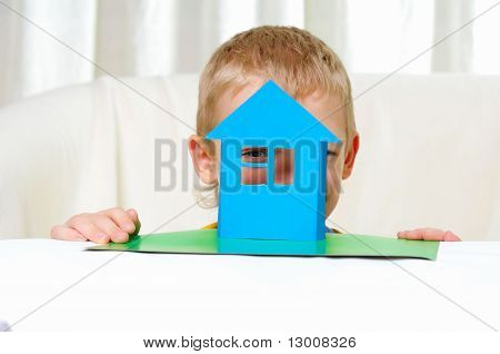 a boy in studio playing with a house