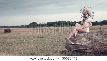 Beautiful ethnic lady with roach on her head on the field