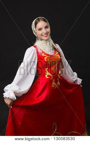 beautiful smiling caucasian girl in russian folk costume studio picture