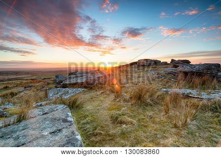 Stunning sunset over slabs of granite rocks at the top of Alex Tor near St Breward on Bodmin Moor in Cornwall