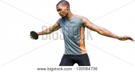 Front view of sportsman practising discus throw