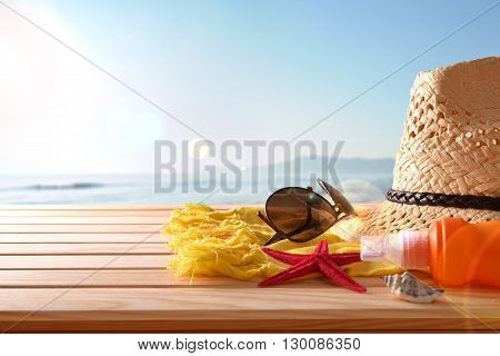 Beach Articles On A Table Wooden Slats And Sea Background