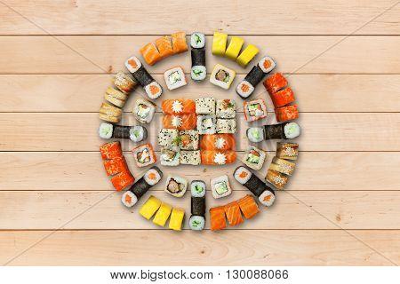 Japanese food restaurant, sushi maki gunkan roll plate or platter set. Sushi at wood background. Top view