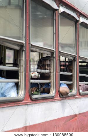 MUMBAI, INDIA - OCTOBER 10, 2015: Unidentified man in the bus. Buses take up over 90% of public transport in Indian cities and serve as a cheap and convenient mode of transport for all classes of society.