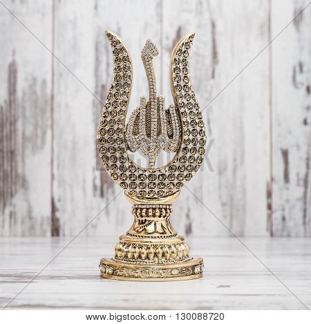 Golden Religious Statuette With The Names Of Allah