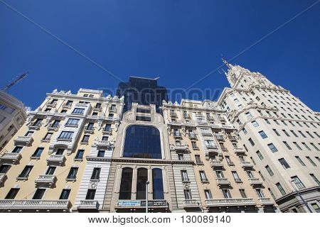 MADRID, SPAIN - MARCH 16, 2016: Building in Gran Via in Madrid. It's the oldest and main shopping street in Madrid.