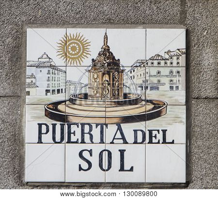 MADRID, SPAIN - MARCH 17, 2016: Closeup of the street sign. Street signs in Madrid are hand-painted ceramic tiles typically composed within 9 or 12 tiles. They depict the name of the alley or street as well as illustrations that indicate special meanings.
