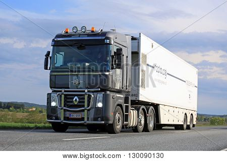 SALO, FINLAND - MAY 13, 2016: Grey Renault Magnum semi truck transports mobile MRI unit in South of Finland on a blue spring evening.