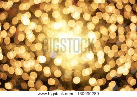 Golden texture bokeh of light. Element of design.