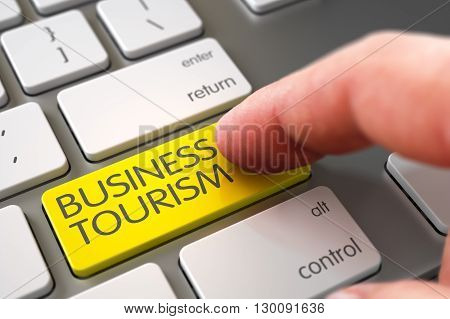 Modern Laptop Keyboard with Business Tourism Yellow Button. Finger Pushing Business Tourism Keypad on White Keyboard. Business Tourism Concept - White Keyboard with Keypad. 3D.
