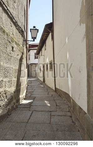 Stone alley in the city of Guimaraes Portugal.