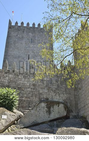 GUIMARAES, PORTUGAL - AUGUST 9, 2016: Tower of the Castle of Guimaraes in the northern region of Portugal. It was built at the end of the 13th century following French influences.