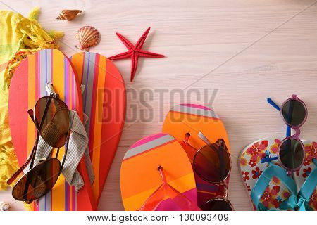 Beach Holiday Articles For Family Prepared On Table Top View
