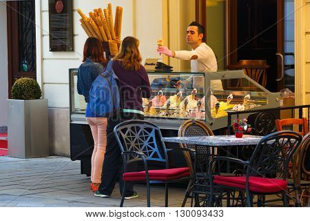 BRATISLAVA, SLOVAKIA - MAY 16, 2016: Ice cream seller in the old town of Bratislava, Slovakia on May 16, 2016.