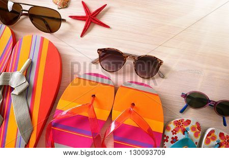 Sunglasses And Flip-flops Family Beach Top View