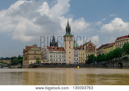Prague, Czech Republic - May 8, 2012: Scenic summer view of the Old Town ancient architecture from Vltava river pier